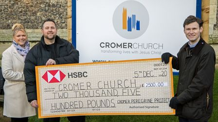 Chris Skipper andKimPaul presenting a cheque toRev Will Warren of Cromer Church for supporting the Cromer Peregrine...