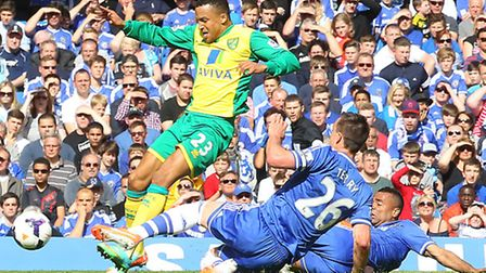 Norwich City's Martin Olsson is upended by Chelsea duo John Terry and Ashley Cole. Picture by Paul C