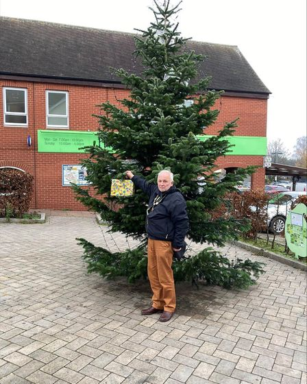 Great Dunmow mayor Mike Coleman with the Christmas tree and one of the festive parcels that councillors have made.