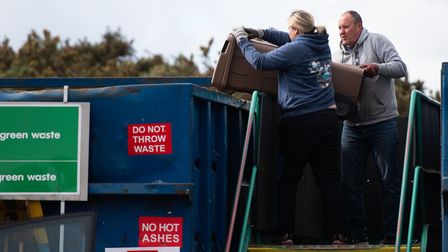Members of the public dispose of their garden waste at Foxhall Recycling Centre