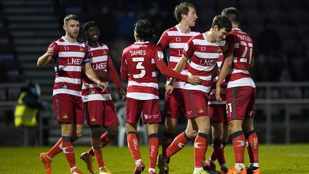 Doncaster Rovers' players celebrate after their sides Joe Wright scores the second goal of the match