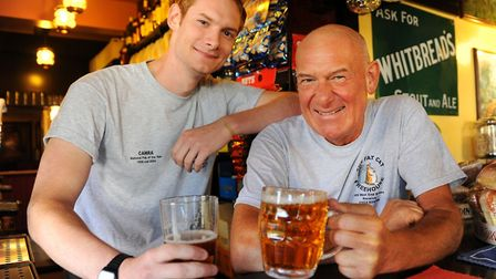 Landlord Colin Keatley with his son Will, at the Fat Cat pub