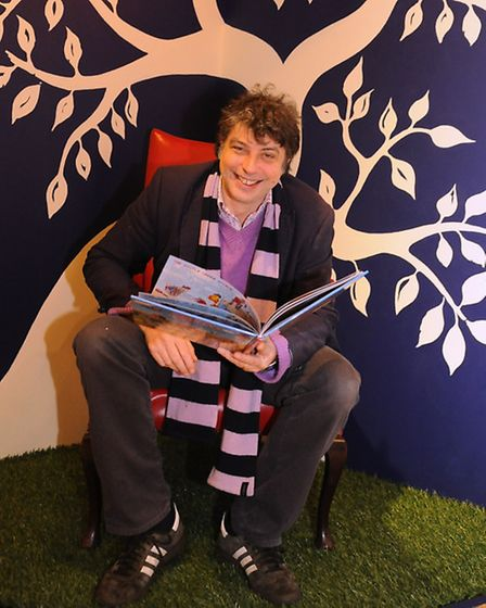 Tom Blofeld of Bewilderwood, ready in the storyteller's chair as a new exhibition, Magic Worlds: Fan