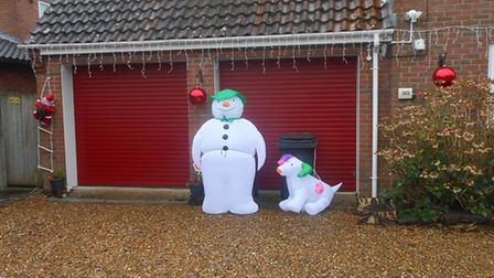 The Snowman and The Snowdog inLesley Caillault's front garden