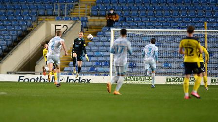 Ipswich keeper David Cornell comes off his line to block during the second half at Oxford United Picture Pagepix Ltd