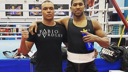 Ipswich's English heavyweight champion Fabio Wardley, left, after sparring with world champion Anthony Joshua in Sheffield...