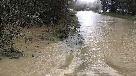 Flooding in Brockley, near Bury St Edmunds, where police were called to help recover five vehicles, including a bus, on...