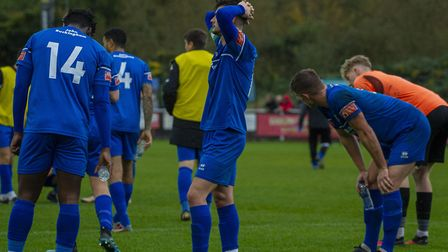 Bury Town players look dejected after the final whistle sounds in their FA Cup defeat at Banbury United. Bury's campaign...