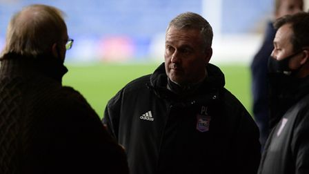 Ipswich Town manager Paul Lambert speaks to owner Marcus Evans and general manager Lee O'Neill befor