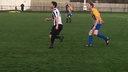 Woodbridge Town striker Mark Ray in action during the FA Vase tie at Wellingborough Town. Picture: CARL MARSTON