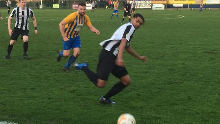 Woodbridge Town winger Kyron Andrews watches the ball drift into touch, during the FA Vase tie at Wellingborough. Picture:...