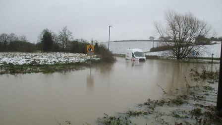 A van stranded in floodwater from the River Brett near Lavenham yesterday. Picture: DAVID LAWS