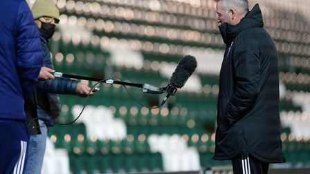 Keeping at arms length: Paul Lambert is interviewed from a distance at Plymouth Picture: PAGEPIX LTD