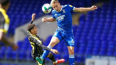Luke Woolfenden wins the ball in the season opener against Bristol Rovers, in the Carabao Cup. Picture: Steve Waller