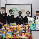 Youngsters from Barking Abbey with donated food. Students at the school have raised ?500 for The Trussell Trust charity. Pict...