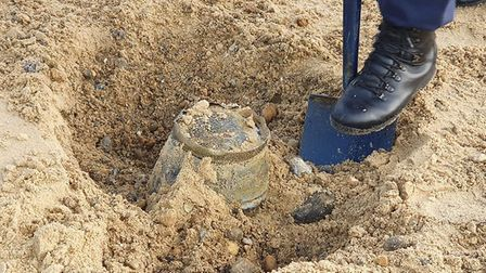 The item was revealed to be a bucket submerged in the sand Picture: Aldeburgh Coastguard Rescue Team