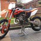 The orange and black KTM 250cc off-road motorcycle which was stolen in a Facebook Marketplace scam in Warren Close...