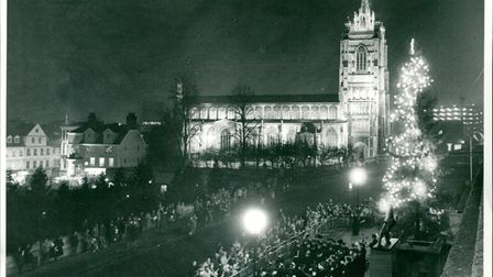 Singers gather around the Norwich Christmas tree as the lights are turned on. Date: december 1984.