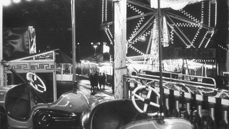 Dodgems lie in wait at six o'clock as the lights go up at the start of Norwich Christmas Fair on the