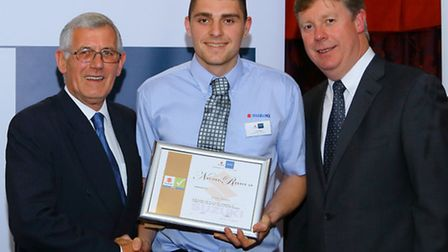 Jordan Beales, centre, receives his Suzuki apprentice of the year silver award from Denis Houston, r