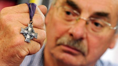 David James holding the Canadian WW1 medal. Picture: Matthew Usher.