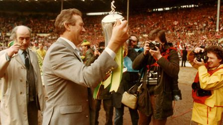 Norwich Manager Ken Brown holds the Milk Cup after Norwich beat Sunderland 1-0 at Wembley on March 2
