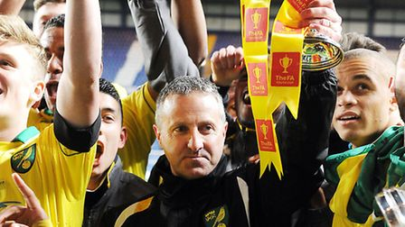 Neil Adams celebrates with his players after victory in the 2013 FA Youth Cup final. Picture: Matthe