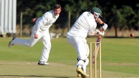 Norwich captain Chris Borrett bowling during a draw with Woolpit in the EAPL earlier this season. Pi