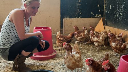 Jo Eglen with some of the hens rescued from the M62.