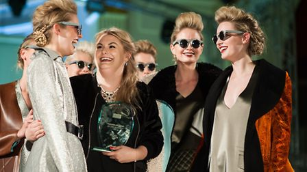 Chloe Fuller, Fashion student of the Year, celebrates with some of her models at last night's NUA sh