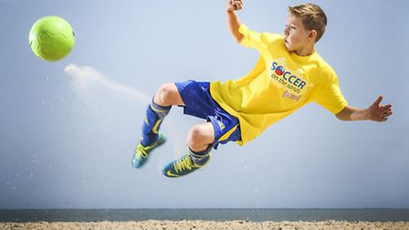 Action from the Soccer on the Sands 2014 tournament on Great Yarmouth beach - Casey Peeke-Vout (10)