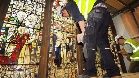 The stained glass windows at Christ Church, Eaton, are put back after their restoration. Tyrone Towe