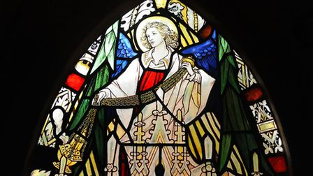 One of the stained glass windows at Christ Church, Eaton, back in place after their restoration. Pic