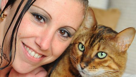 Tara Kelf with her cat, Rossco, who has been returned after going missing for two months. Picture: D