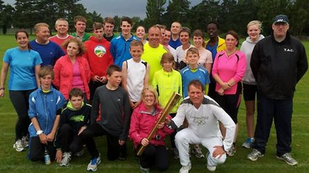 Former Olympian Paul Evans brought the Olympic Torch to Thetford Athletics Club in July 2012, one of