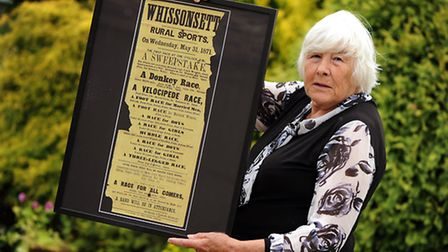 Ann English with the poster which has returned to Whissonsett from America after 150 years. Picture: