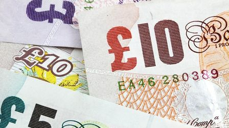 A group of British bank notes in denominations of five, ten and 20 pounds