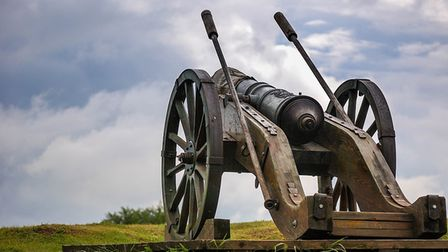 A picture of an old-fashioned cannon in a field