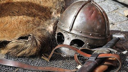 Old-fashioned armour including a helmet, furs and a scabbard