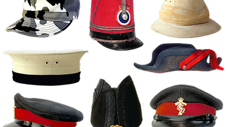 A selection of nine military hats