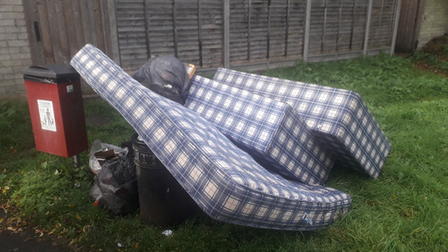 A family has been fined for dumping a mattress and bedding beside a public bin on Dane Close, Thetford