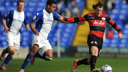 Birmingham City's Tom Adeyemi (left) and Queens Park Rangers Joey Barton (right) battle for the ball