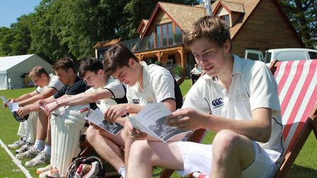 Gresham's senior school cricket team members relax before taking on a team of Old Greshamians in a m