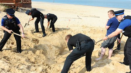 Emergency services at the scene on Caister beach filling in the hole. Picture: James Bass