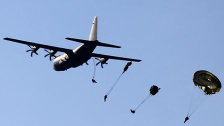 Soldiers parachute from a C130 Hercules. Photo: Andrew Milligan/PA Wire