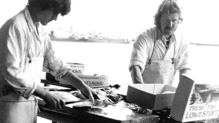 Port People exhibition at Lowestoft Record Office. Gassey Cook and Vic King preparing fish.