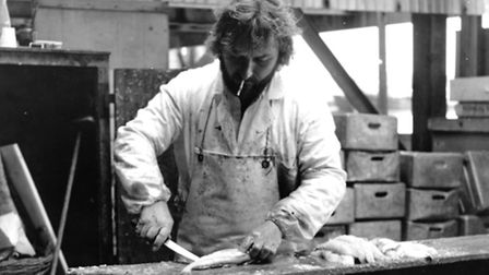 Port People exhibition at Lowestoft Record Office. Rodney Reeve preparing fish.