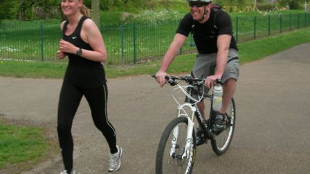 Kathryn Dugdale-Evans running her own personal Race for Life. Here she is with her husband Lee cycli
