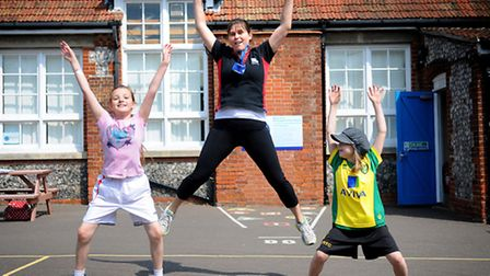 NNDC fitness roadshow at Northrepps Primary School. NNDC fitness instructor Karle Parnell with, left