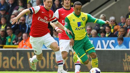 Mesut Ozil of Arsenal and Nathan Redmond of Norwich in action during the Barclays Premier League mat